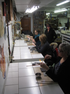 Lampworker Cynthia Legere, teaching a bead making class.